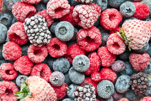 frozen mix berries background - frozen stock pictures, royalty-free photos & images