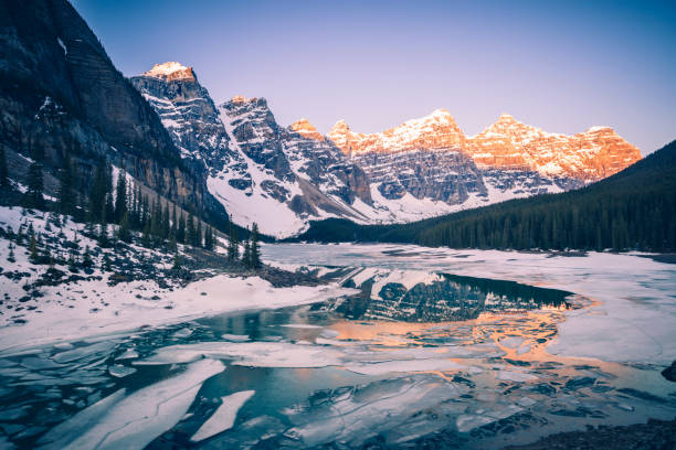Frozen Moraine Lake in Banff National Park Frozen Moraine Lake in Banff National Park.  Banff National Park,Alberta, Canada. moraine lake stock pictures, royalty-free photos & images
