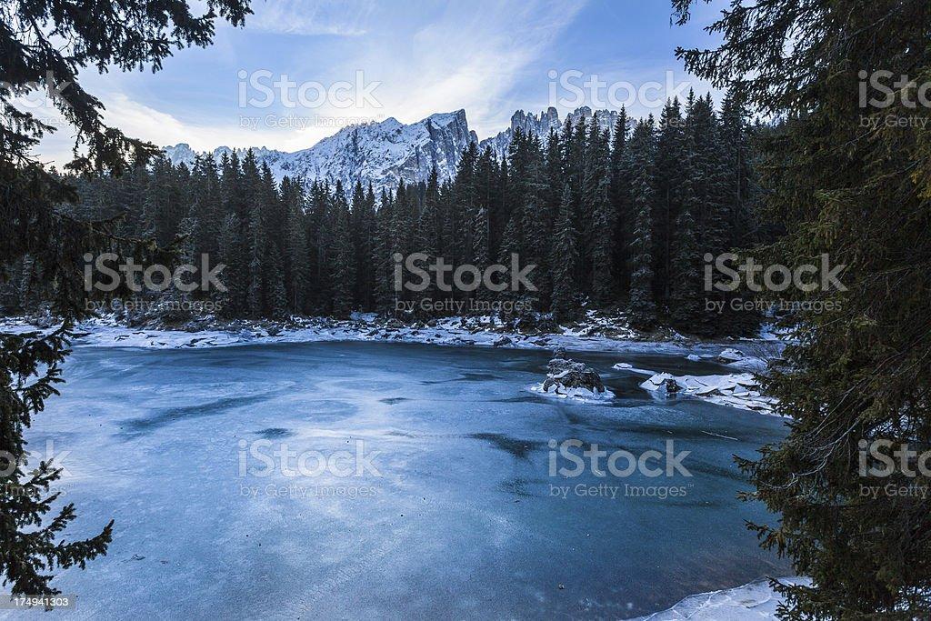 Frozen Mountain Lake of Carezza, Dolomites, Italy royalty-free stock photo