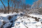 Frozen mountain river at winter season
