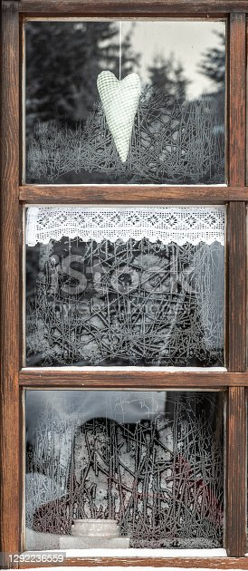 Frozen old window with decoration