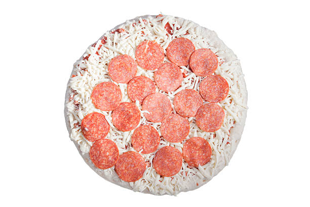 frozen perpperoni pizza on white - frozen stock photos and pictures