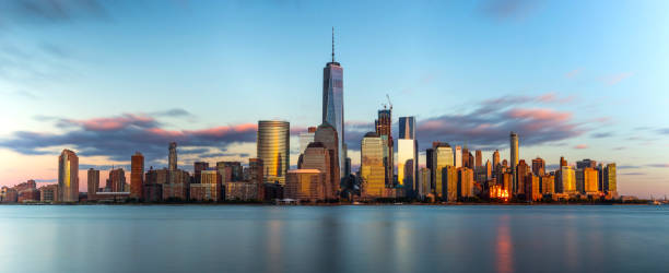 Frozen A long exposure panorama of downtown New York skyline during a beautiful sunset. lower manhattan stock pictures, royalty-free photos & images