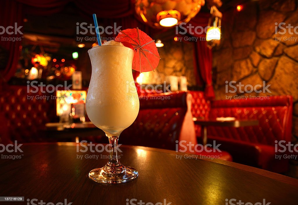 Frozen Pina Colada in a glass with an umbrella stock photo