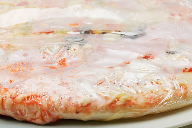 Frozen pizza closeup stock photo