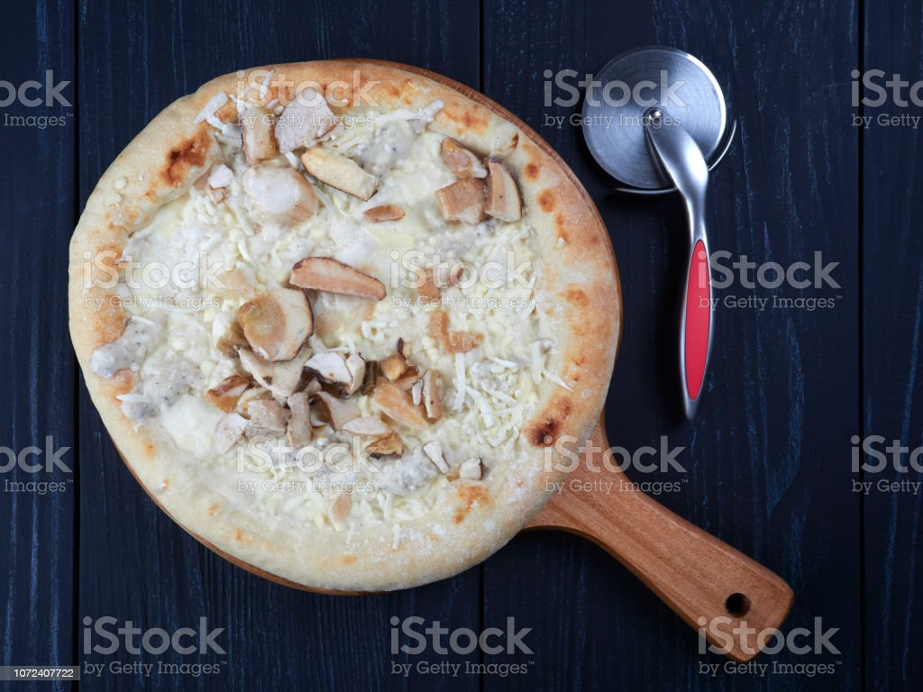 Frozen pizza with porcini and truffle stock photo