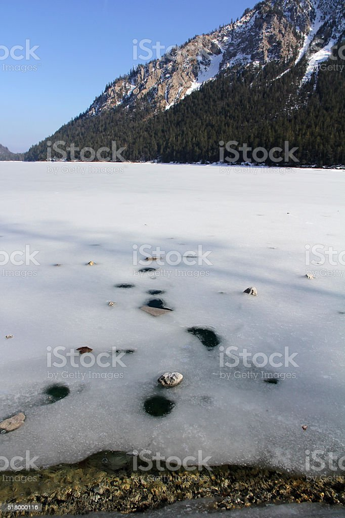 frozen Plansee in Austria stock photo