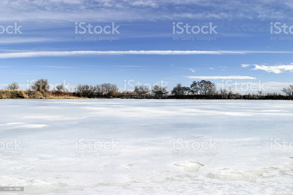 Frozen Pond with Winter Snow & Ice stock photo