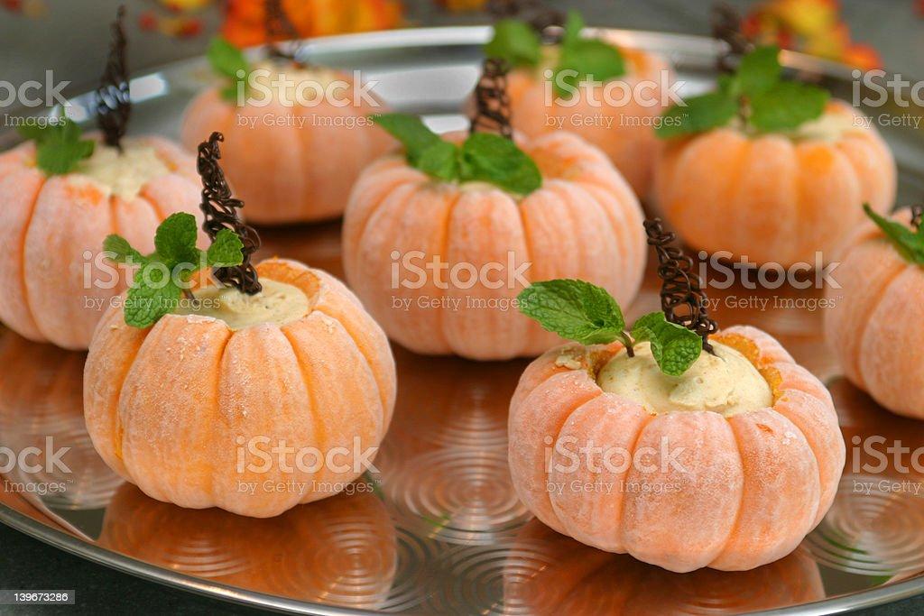 Frozen Pumpkin shaped desserts. stock photo