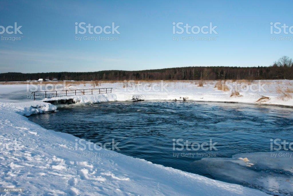 Frozen river in winter stock photo