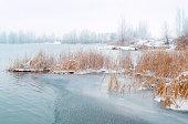 Frozen river in winter scenery.
