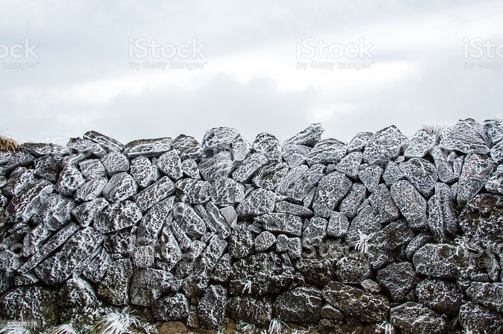 Frozen rocks due to cold temperature and wind stock photo