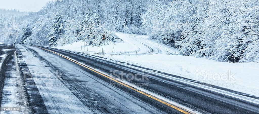 Frozen Rural Highway and Winding Country Road Blizzard Snow Storm stock photo