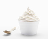 SEVERAL MORE IN THIS SERIES. Cup of plain vanilla frozen yogurt or soft serve ice cream with an eco-spoon made of bamboo.   High resolution XXXL image with various crops possible.