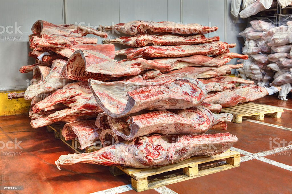 frozen stocks of red meat in a cold warehouse stock photo