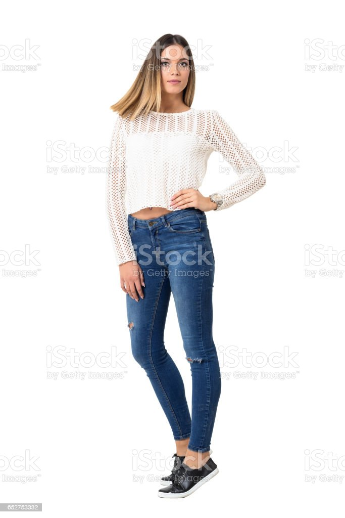 Frozen straight hair motion of young casual girl wearing braided shirt. stock photo