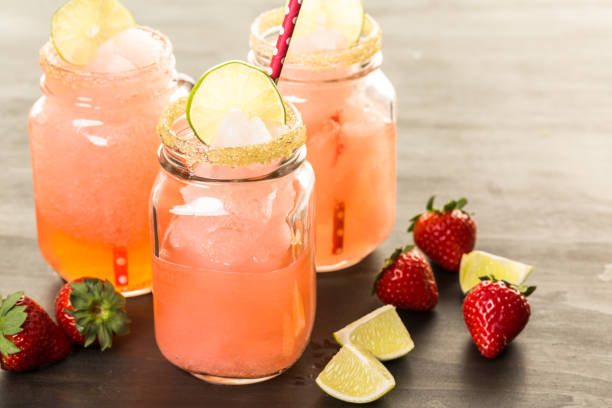 frozen strawberry margarita cocktail - margarita drink stock photos and pictures