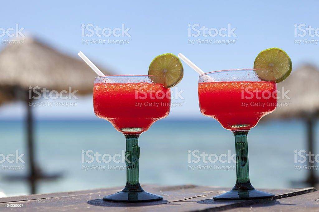 Frozen strawberry margaritas on the beach royalty-free stock photo