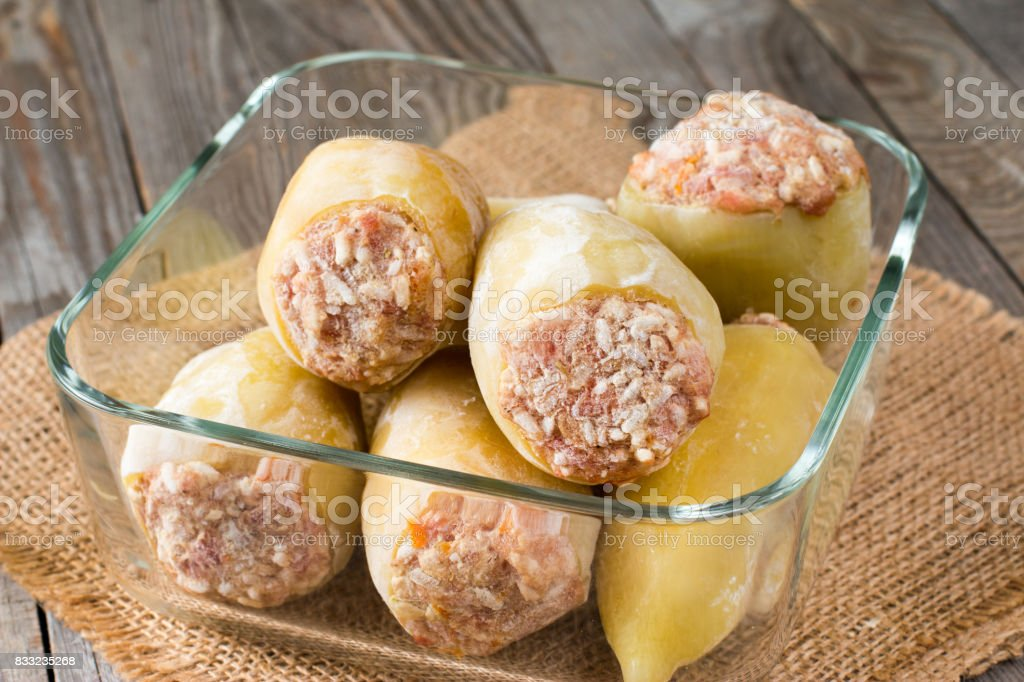 Frozen stuffed pepper in a container stock photo