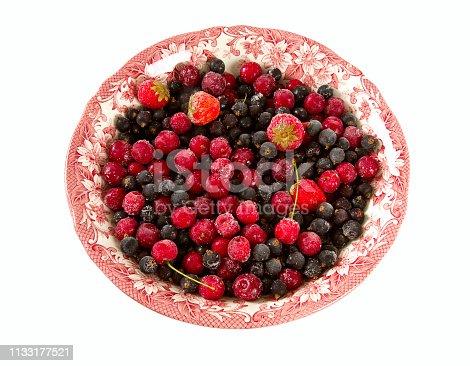 827935944 istock photo frozen summer berries isolated on white 1133177521