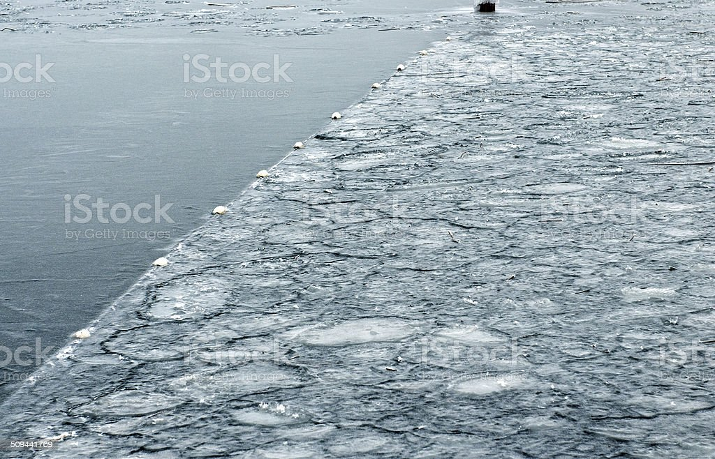 Frozen swimming area and buoys in lake royalty-free stock photo