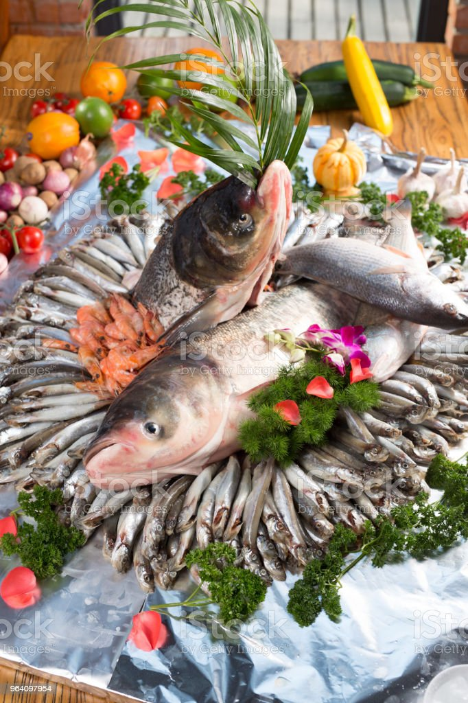 Frozen unripe fish on the table - Royalty-free Animal Body Part Stock Photo