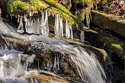Frozen water hangs over a small stream in the Smokies.