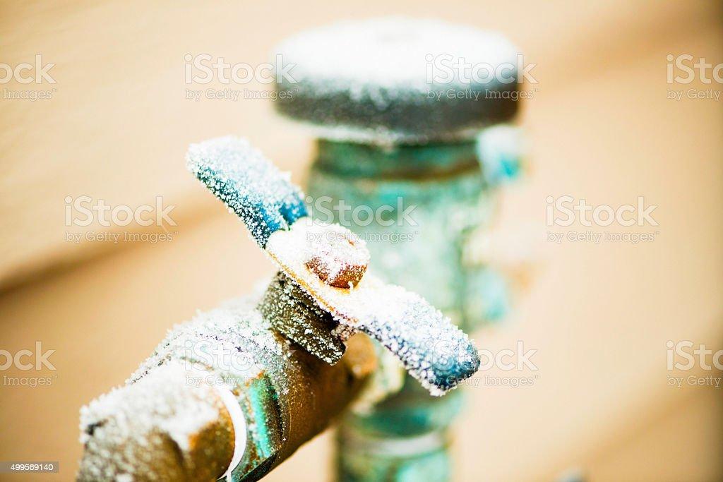 Frozen water shut off handle in snowstorm stock photo