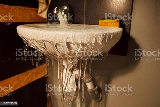 Photo of Frozen water spilling out of restroom sink