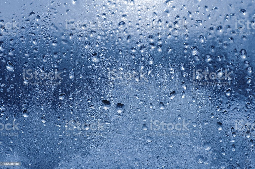 Frozen water-drops on glass stock photo