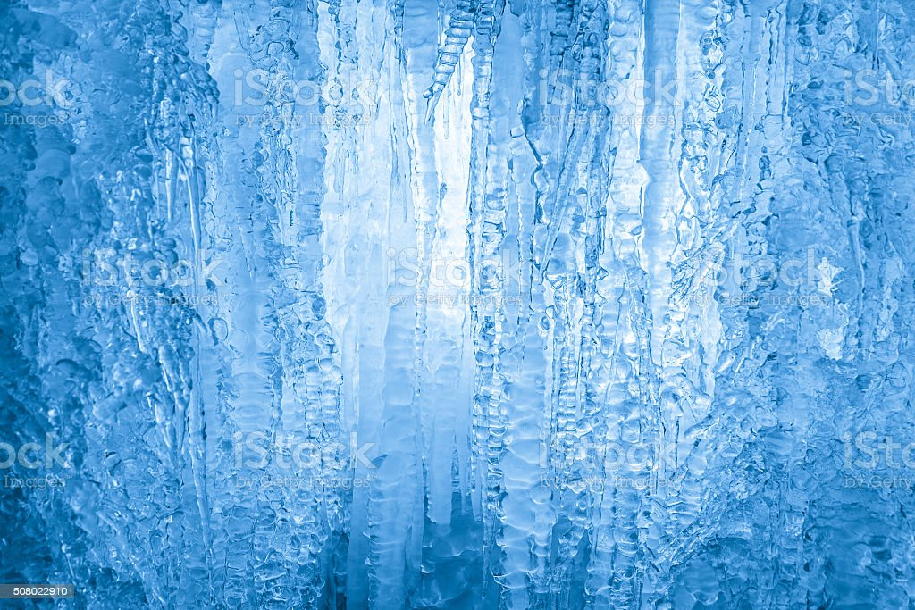 Frozen waterfall. Icicles structure stock photo