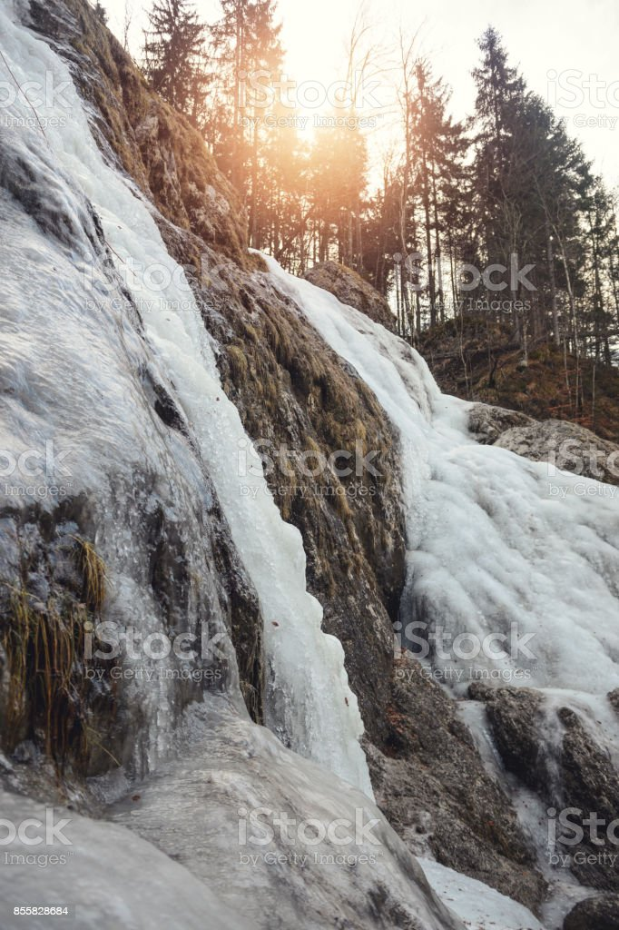 Frozen waterfall in early morning stock photo