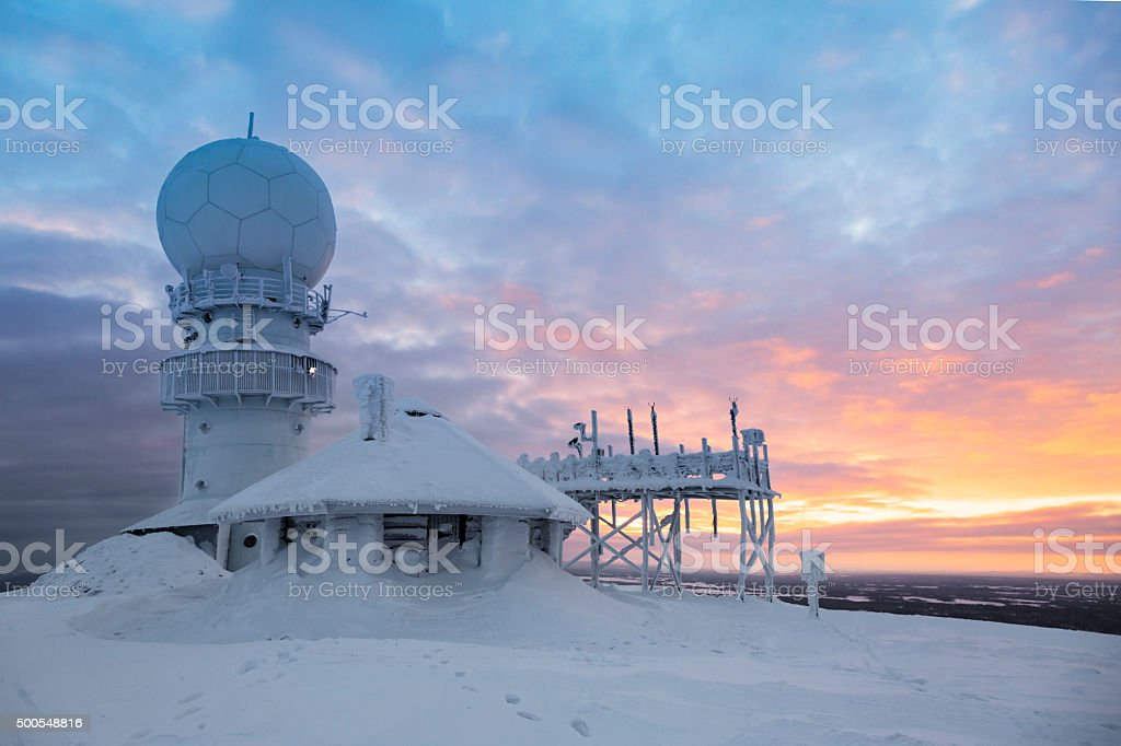 frozen weather radar station on the top of the mountain stock photo