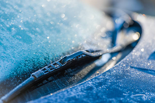 Frozen windshield Frozen windshield, cold weather, sunlight on backlight, focus on foreground windshield wiper stock pictures, royalty-free photos & images