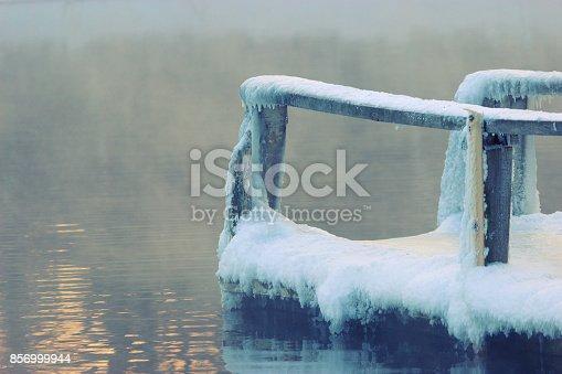 istock frozen wooden bridge 856999944