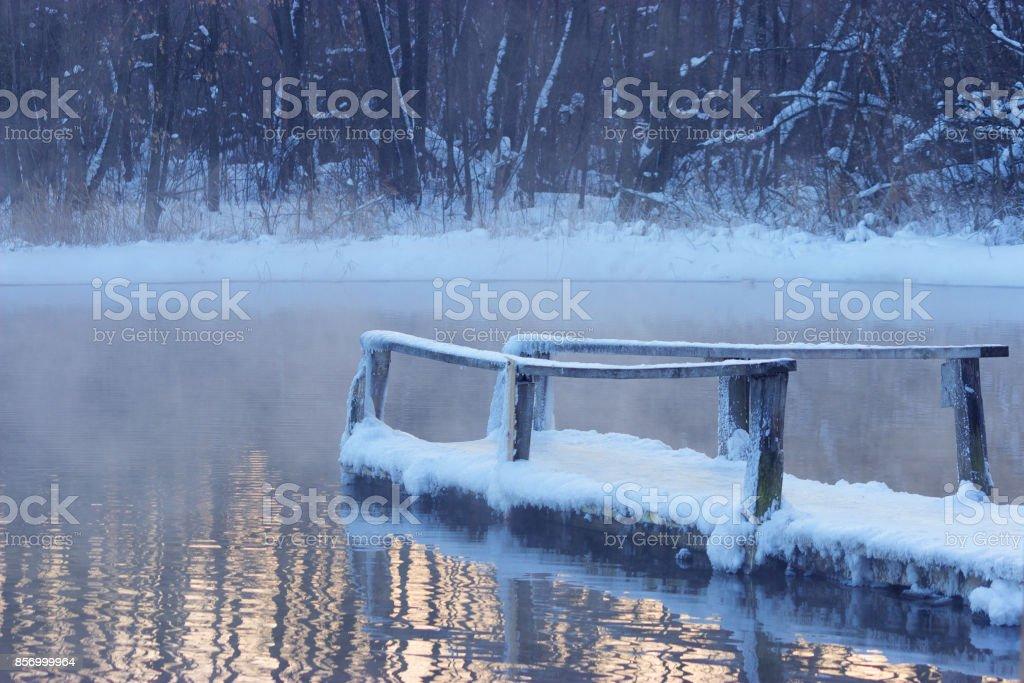 frozen wooden bridge stock photo