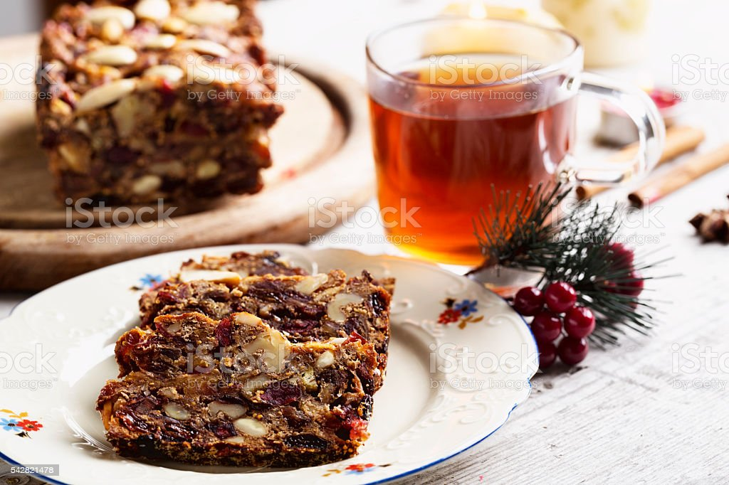 Fruechtebrot bread slices made from dried fruit with tea stock photo