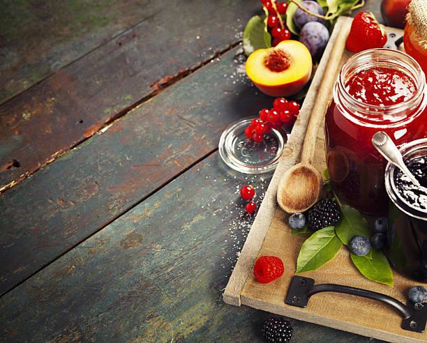 fruit and berry jam on a wooden background - ribiselmarmelade stock-fotos und bilder