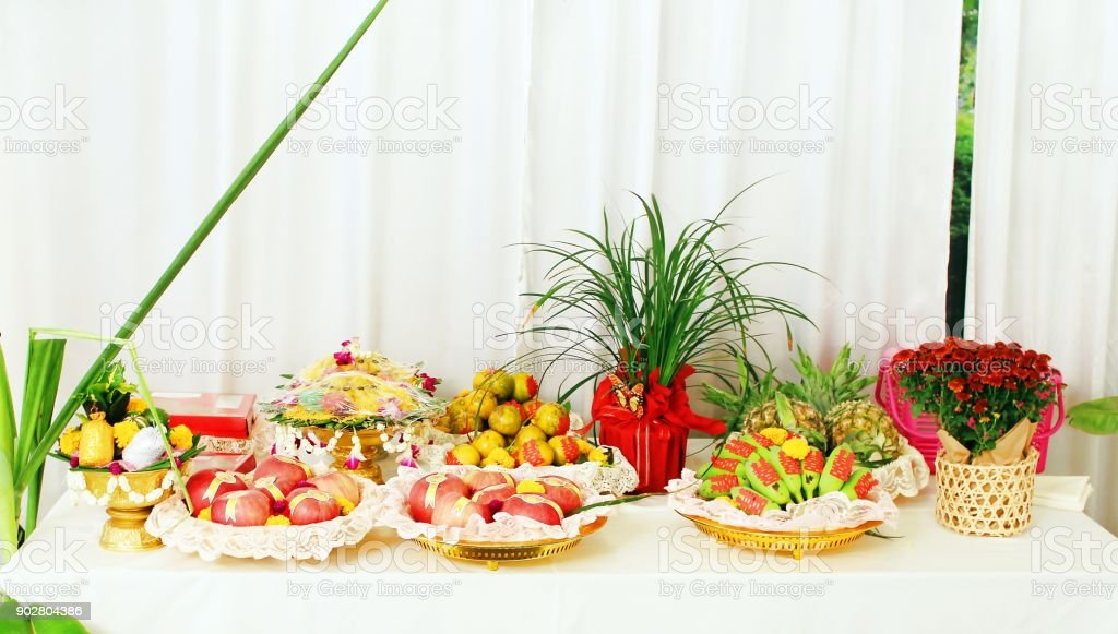 Fruit and food in Chinese wedding ceremonies are placed on a white table in Thailand. stock photo