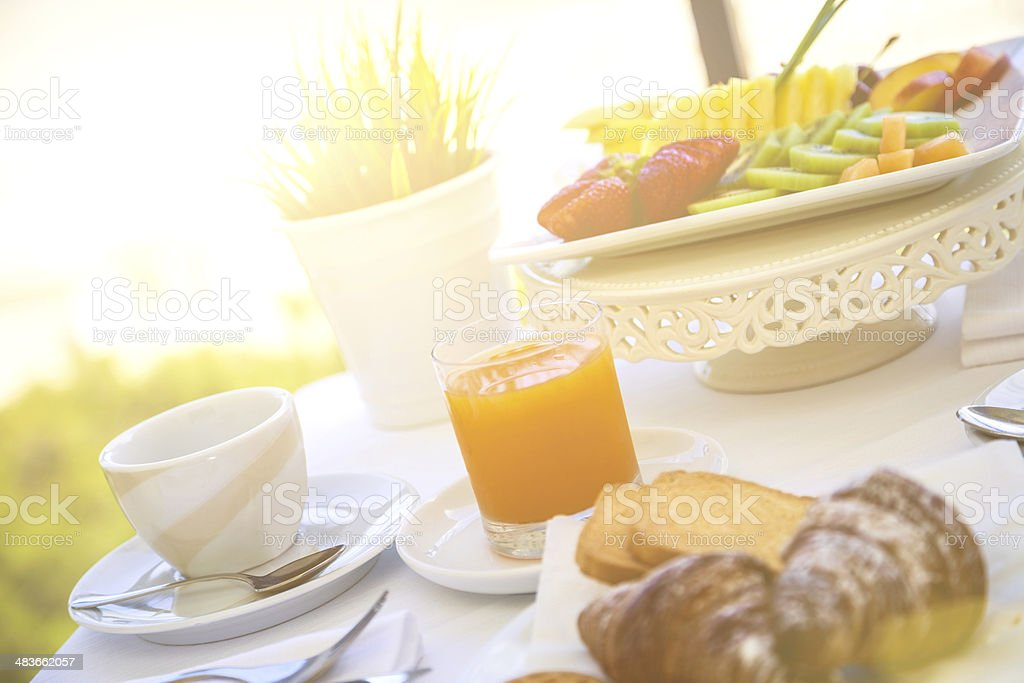 Fruit and orange juice in front of the sea royalty-free stock photo