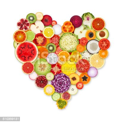Heart shape made from 49 fruits and vegetables colorful portions on white background.