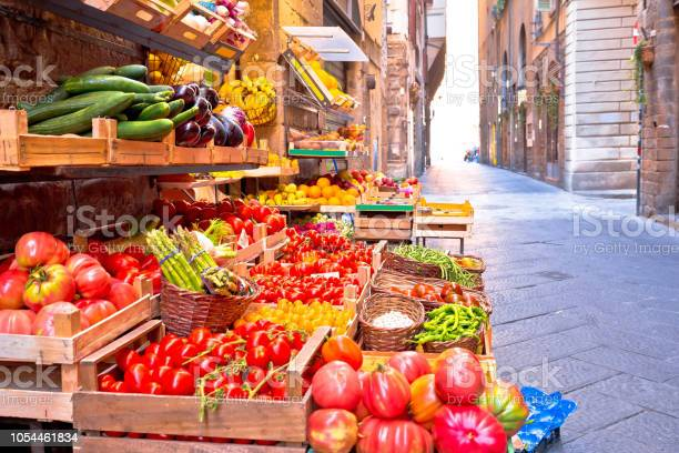 Fruit and vegetable market in narrow florence street tuscany region picture id1054461834?b=1&k=6&m=1054461834&s=612x612&h=vui4emrc42xrecv1dxseiiy2lp5hqdftwf3fbbsqclq=