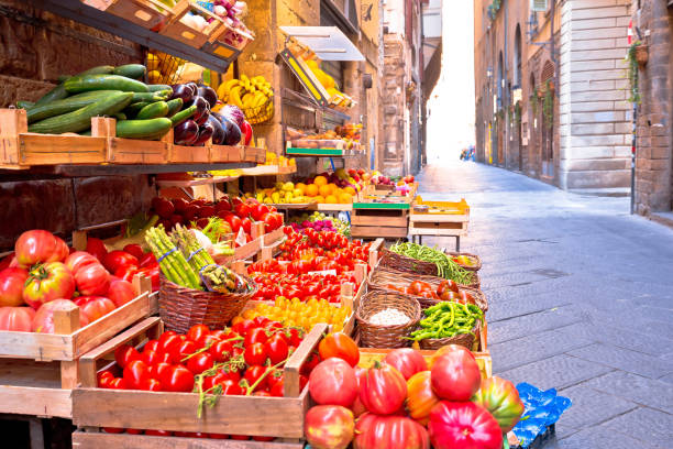 Fruit and vegetable market in narrow Florence street, Tuscany region of Italy Fruit and vegetable market in narrow Florence street, Tuscany region of Italy florence italy stock pictures, royalty-free photos & images