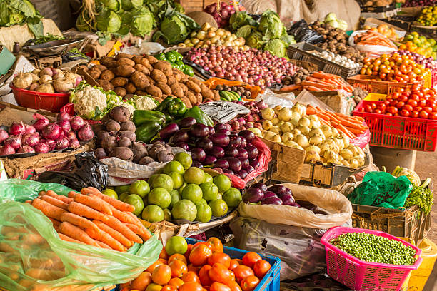 Fruit and Vegetable Market Colorful fruits and vegetables colorfully arranged at a local fruit and vegetable market in Nairobi, Kenya. east africa stock pictures, royalty-free photos & images