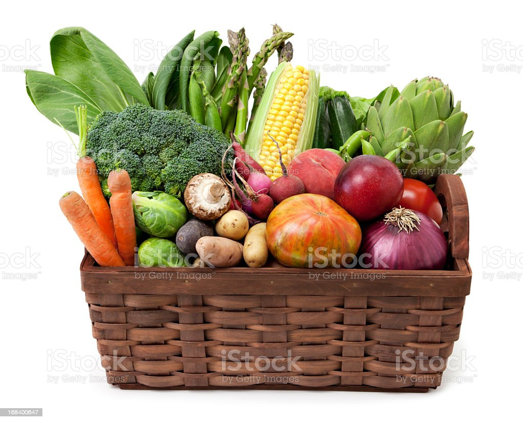Fruit and vegetables basket stock photo