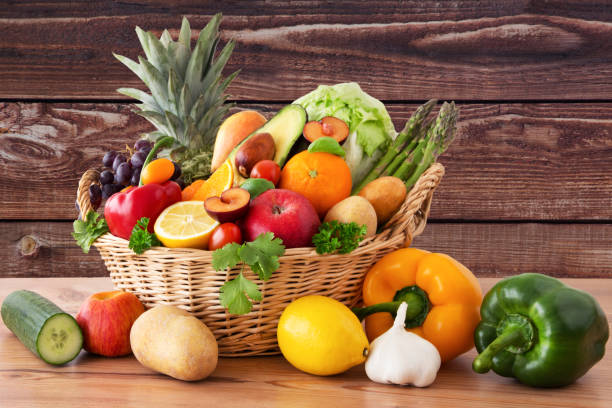 Fruit and vegetables in a basket stock photo