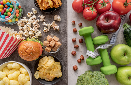 Fruit and vegetables vs sweets and potato fries top view flat lay