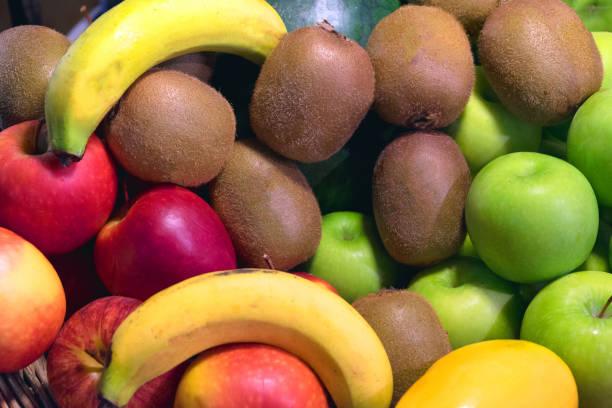 Fruit background, many fresh fruits mixed together stock photo