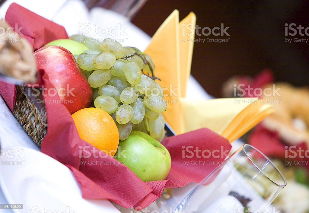 Fruit basket on the table in a restaurant stock photo