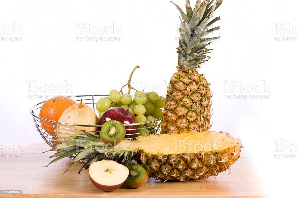 fruit basket pineapple, grape, orange, pear, kiwi, panier royalty-free stock photo